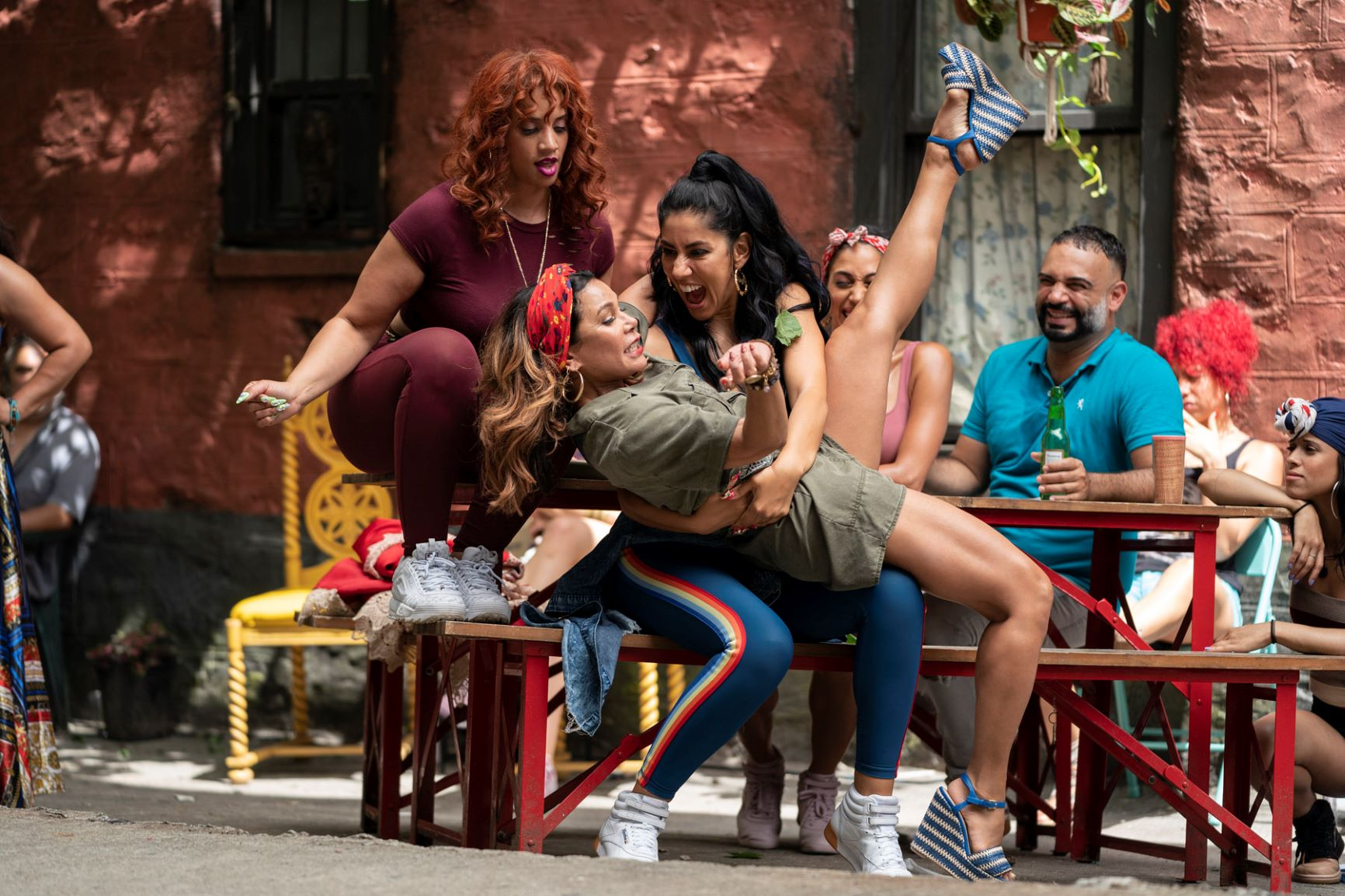 """(L-r) DASCHA POLANCO as Cuca, DAPHNE RUBIN-VEGA as Daniela and STEPHANIE BEATRIZ as Carla in Warner Bros. Pictures' """"IN THE HEIGHTS,"""" a Warner Bros. Pictures release. Photo by Macall Polay"""
